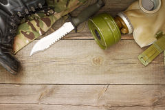 Military accessories on wooden boards Royalty Free Stock Photos
