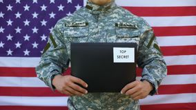 Military agent holding top secret folder, government agency, national security. Stock footage stock footage