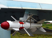 Military air equipment. Fighting Rocket aboard a military aircraft royalty free stock images