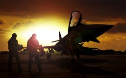 Military aircraft on airfield with pilot walking Royalty Free Stock Photography