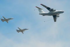 Military aircraft with fuel and two fighters in the sky Royalty Free Stock Images