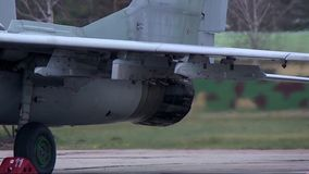 Military aircraft MIG 29 warms up the engine. Military aircraft MIG 29 is in the Parking lot 2 stock footage