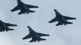 Military aircraft su 35 fly to war in slow motion. Airplanes soar in the air.