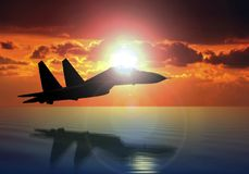 Military aircraft on sunset background. Military aircraft  on sunset background above the ocean Royalty Free Stock Photography