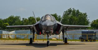 Military aircrafts for display in Singapore. Singapore - Feb 10, 2018. A Lockheed Martin F-35 Lightning II aircraft belong to the US Marine sits on display in Stock Image