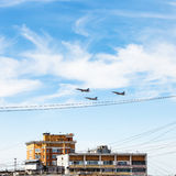 Military aircrafts flight over urban house Royalty Free Stock Photo