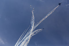 Military aircrafts making a stunt with fireworks Stock Image