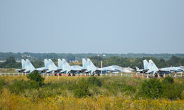 Military airfield and parking lots of planes. Royalty Free Stock Images