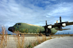 Military airplane. In an airbase at daylight - C130 Stock Images