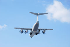 Military airplane with four helix Royalty Free Stock Photo