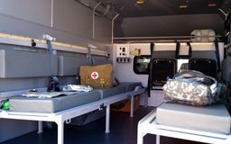 Military ambulance inside. first aid kit Stock Image