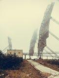 Military antennas in fog Stock Photos