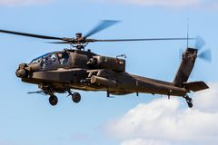 military Apache attack helicopter hovering stock images
