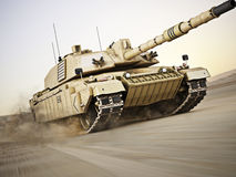 Military armored tank moving at a high rate of speed. With motion blur over sand. Generic photo realistic 3d model scene Stock Photography