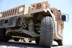 Military armored vehicle. Closeup isolated on a clear blue sky background royalty free stock images