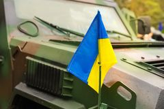 Military armored vehicle with the flag of Ukraine. Military armored vehicle with the flag of Ukraine royalty free stock images