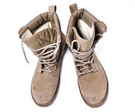 Military Army Boots. A pair of army boots for desert deployment. ; slightly worn Focus = front laces ; isolated Stock Image