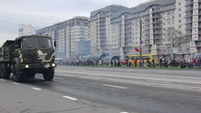 Military army invasion of the city, armored troop-carrier, danger, smoke. Russian army, special car transports Battle Tank stock footage