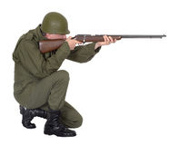 Military Army Soldier Shooting Rifle Gun, Isolated. A military army soldier is shooting a rifle gun. The uniform fatigues on the man are of a retro style royalty free stock images
