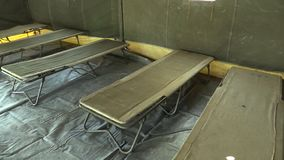 Military army tent with polyethylene PE highly resistant and solid, used in field missions in Afghanistan, mobile deck. Chairs, day of the Army of the Czech stock footage