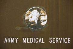 Military background with medical symbol Royalty Free Stock Image