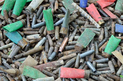 Military background of used shells. A lot of utilized cases and shells are heaped after shooting Stock Photos