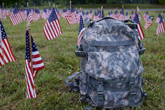 Military backpack and american flags Stock Photo