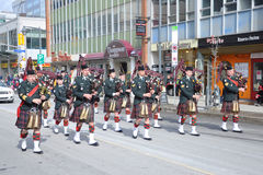 Military Bagpipers in Saint Patrick's Day parade Stock Photo
