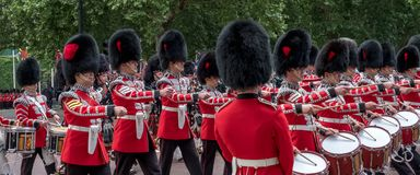 Military band belonging to the Irish Guards marches down The Mall during the Trooping the Colour military parade, London UK. London UK. Military band of Irish Stock Photo