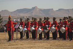 Military Band and conductor. Military band of the Lesotho Defense Force at H.R.H King Letsie's Birthday Parade in Lesotho, against a typical backdrop of Maluti Stock Images