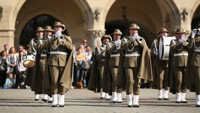 Military Band on main square of Krakow during annual Polish national and public holiday the Constitution Day. stock footage