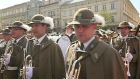 Military Band on main square of Krakow during annual Polish national and public holiday the Constitution Day. stock video