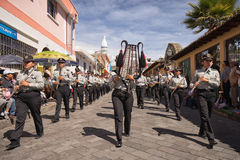 Military band marching on street royalty free stock photo
