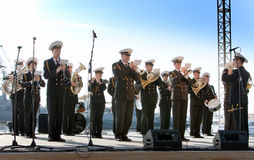 Military band musicians perform on city holiday Royalty Free Stock Photo