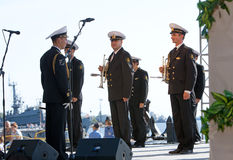 Military band musicians perform on city holiday Stock Image