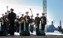 Military band musicians perform on a city holiday Royalty Free Stock Photo