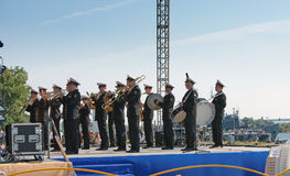Military band musicians perform on a city holiday Stock Photography