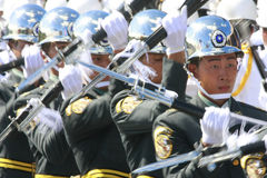Military band spin gun. Soldiers spin gun by turns at the national day in Taiwan on Oct. 10, 2008 Royalty Free Stock Photography