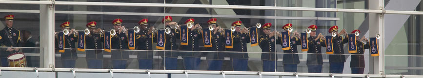 A military band of trumpeters performs on the balcony of the Clinton Presidential Library.  Former U.S. President Bill Clinton wil Stock Photos