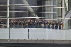 A military band of trumpeters performs on the balcony of the Clinton Presidential Library.  Former U.S. President Bill Clinton wil Stock Photography