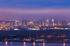 Military base with San Diego skyline in background after dusk Stock Image