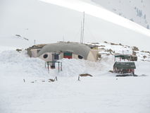 Military base on snow clad mountains Stock Photos