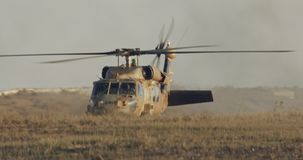 Military BlackHawk helicopter during a rescue mission in a base