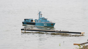 Military boat near berth. Remote controlled military boat approaching to a berth Stock Image