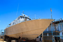 Military boat on repair in dry dock Stock Images