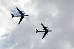 Military bomber against cloudy sky Stock Image
