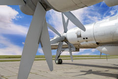 Military bomber plane. Backside view of military bomber plane for nuclear weapon with turboprop engines with double propellers Stock Image