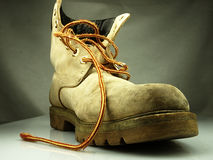 Military boot. Old heavy and destroyed. Stock Image