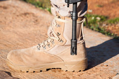 Military boots. Arid color along rifle canyon Stock Photography