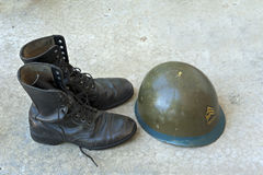 Military boots and helmet Royalty Free Stock Images
